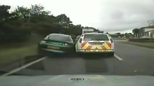Police car ramming another car off the road