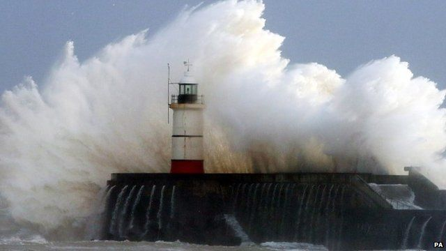 Wave crashing over harbour wall in Sussex