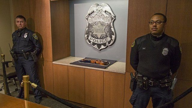 Wisconsin police stand guard over the recovered Stradivarius violin. 6 Feb 2014
