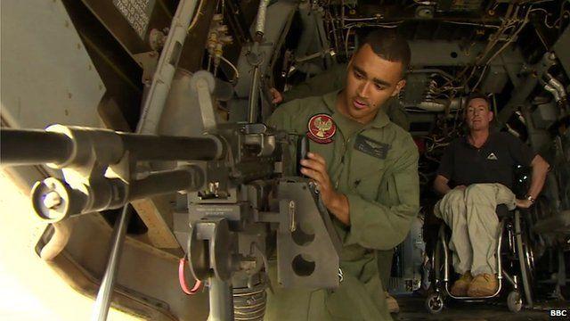US Marine gunner demonstrates weaponry on board MV-22 Osprey aircraft