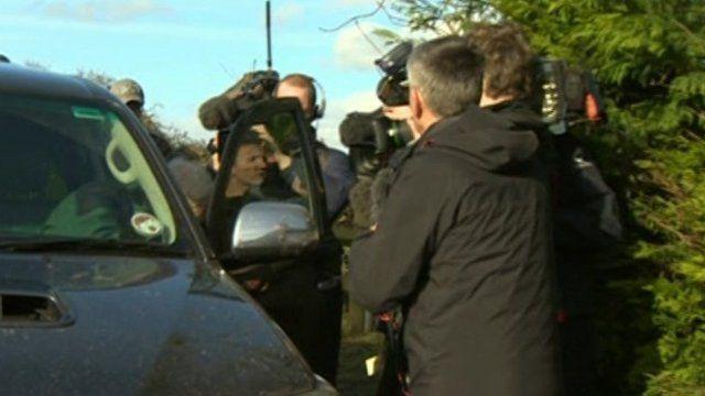 Media scrum around minister
