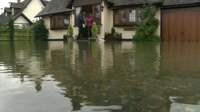 House surrounded by floodwater
