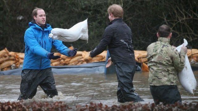 Prince William and Harry shift sandbags