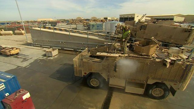 Cleaning a truck in Afghanistan