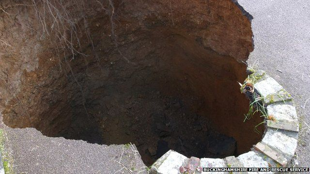 A 30ft deep sinkhole which opened up in the driveway of a house in High Wycombe