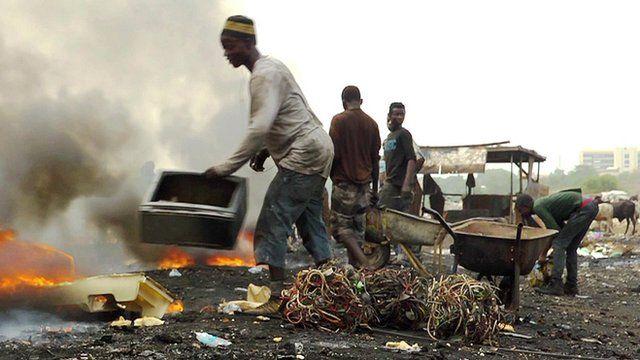 A man sorts e-waste in Agbogbloshie, Ghana