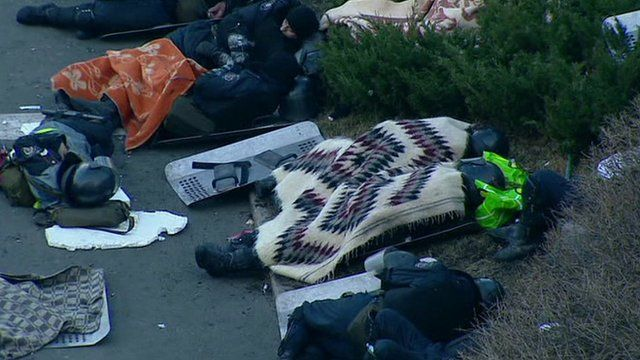 Police sleep in Independence Square