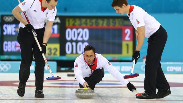 Wales coach Adrian Meikle talks Ayshah through the tools of the curling trade