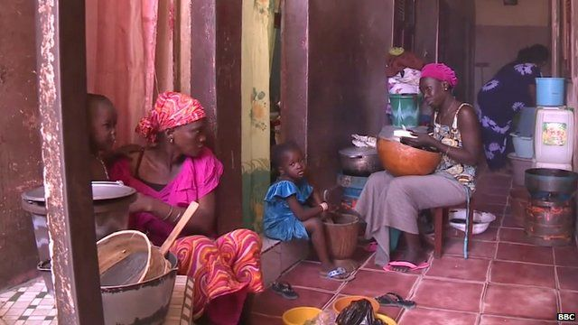 Dakar tenants sharing a hallway as a kitchen