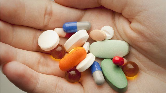 Pills on a person's palm