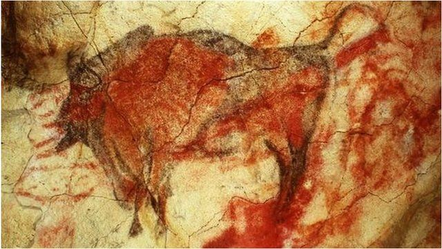 A painting of a large male bison on the ceiling of the caves' polychrome chamber, shown in a 1985 file photo