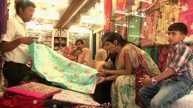 people looking at saris