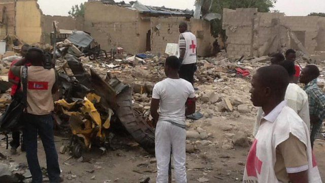Red Cross workers survey damage