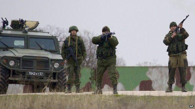 Russian soldiers firing warning shots at the Belbek air base