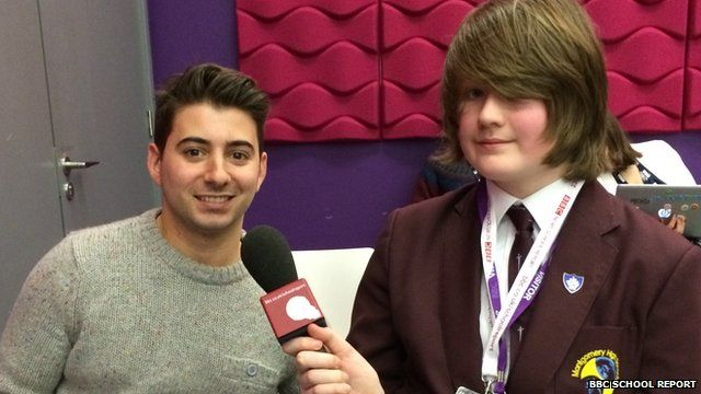 Luke from Montgomery High School interviewing Newsround presenter Ricky Boleto
