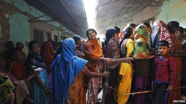 Voters line up outside a polling booth during the state assembly election in Delhi on December 4, 2013.