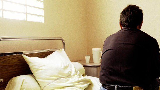 Man sitting on hospital bed