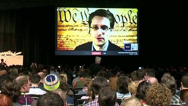 Edward Snowden speaking to technology innovators via video link at SXSW