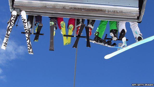 A family on a ski lift