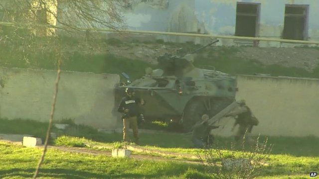 Russian military vehicle breaching a wall