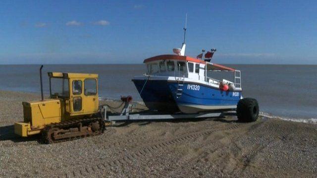 Kirk Stribling launching boat at Aldeburgh