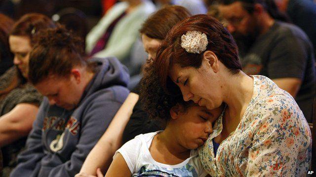 Arlington residents pray in the town's church