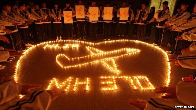Students pray for missing plane passengers