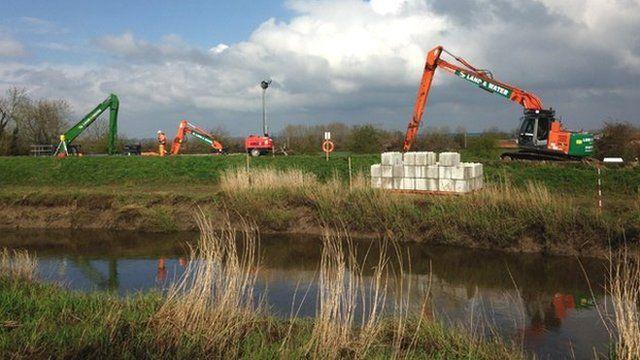 Dredging equipment beside a Somerset river