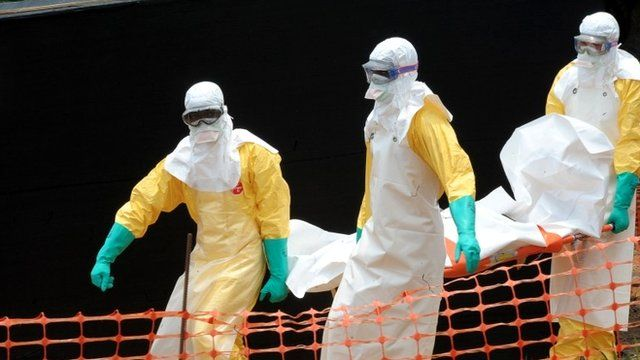 MSF aid organisation carry the body of a person killed by the Ebola virus in Guinea