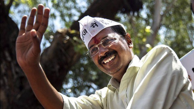 Leader of the AAP, Arvind Kejriwal waves to supporters