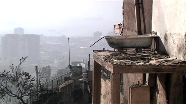 Bathroom left exposed on side of building after Chile fire