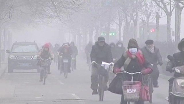 People wearing face masks on bikes