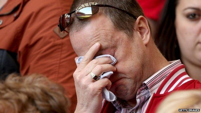 Liverpool supporter wiping tears