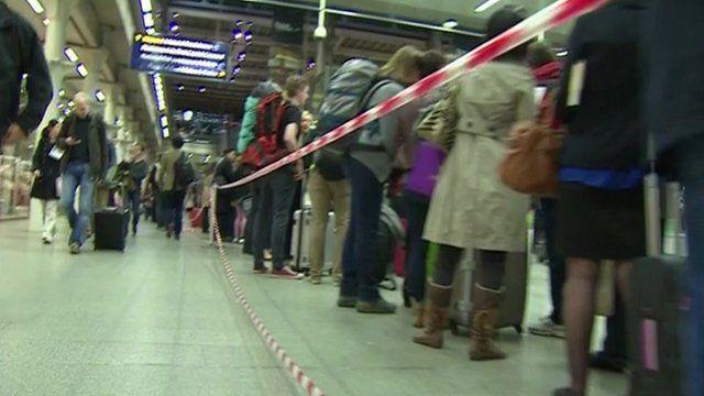 Eurostar passengers queue at St Pancras