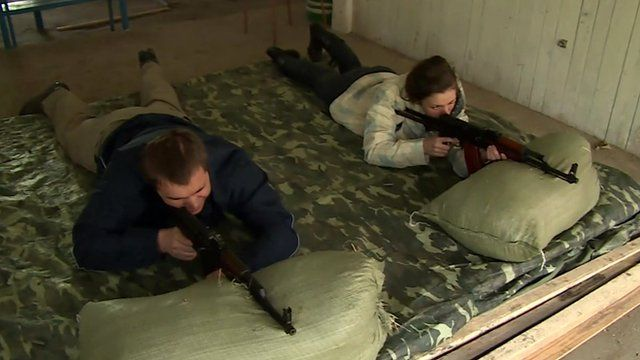 Ukrainian civilians training to use firearms