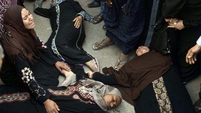 Collapsed relatives outside Egypt court