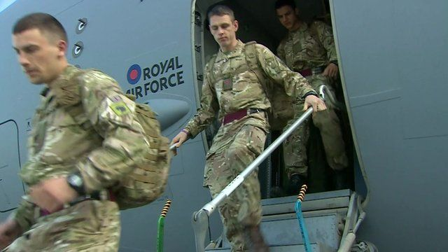 British troops get off military plane