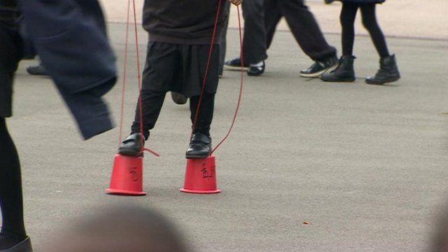 A child walking on stilts