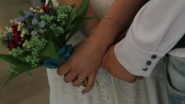 Hands of gay couple at their wedding