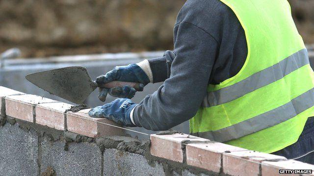 A builder laying bricks