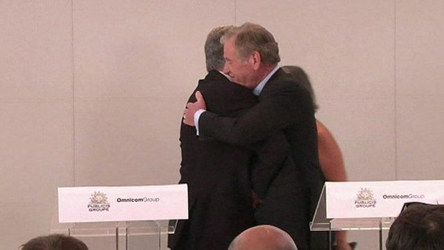 Happier times - chief executives Maurice Levy and John Wren hug each other