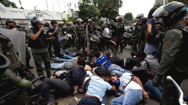 Police surround a group of anti-government demonstrators