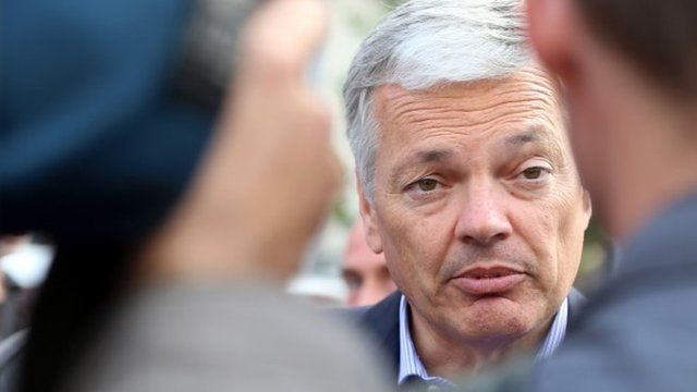 Belgian Foreign Minister Didier Reynders speaks to journalists at the scene of a shooting near the Jewish Museum in Brussels