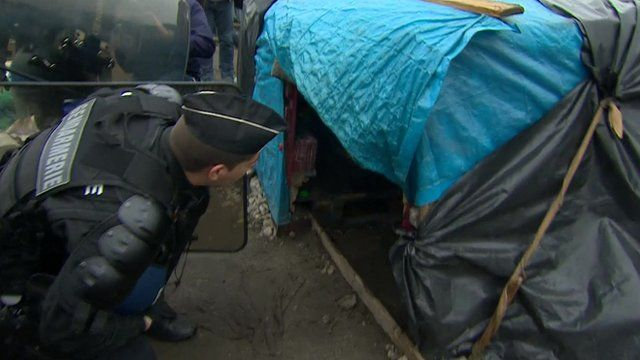 Police evicting migrants from illegal camp