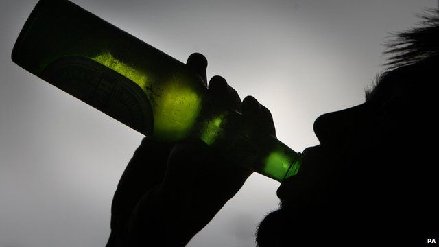 Person drinking a bottle of beer