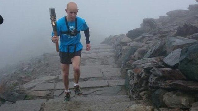 Eryri Harriers with the Queen's Baton on Snowdon