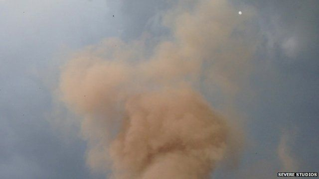 Still from amateur footage shows smoke rising