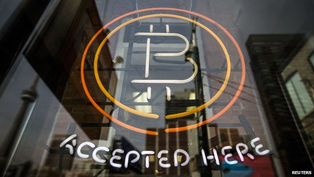 """A sign reads """"Bitcoin accepted here"""""""
