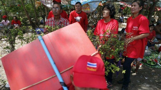 "Pro-government ""red shirt"" supporters listen to their leader""s speech inside their encampment in the suburbs of Bangkok May 20, 2014"