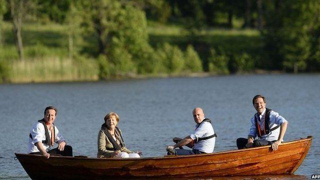 David Cameron, Angela Merkel, Fredrik Reinfeldt and Mark Rutte talk in a boat near the summer residence of the Swedish Prime Minister